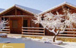 casas-de-madera-nevadas